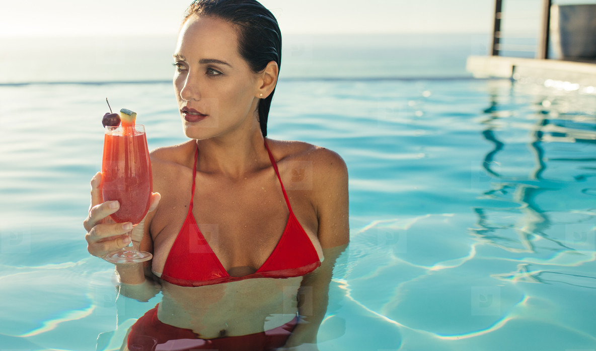 eb807beabbb Photos - Beautiful woman in swimming pool with cocktail - YouWorkForThem