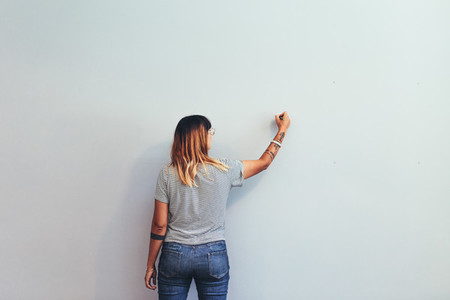 Woman drawing on a wall