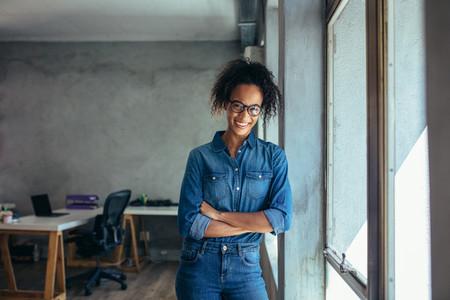 Confident entrepreneur in her office
