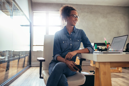Young woman entrepreneur at her desk