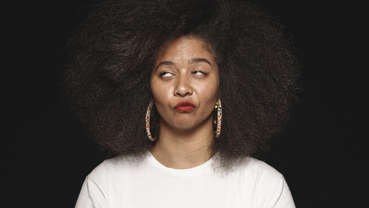 Woman in afro hairstyle making faces