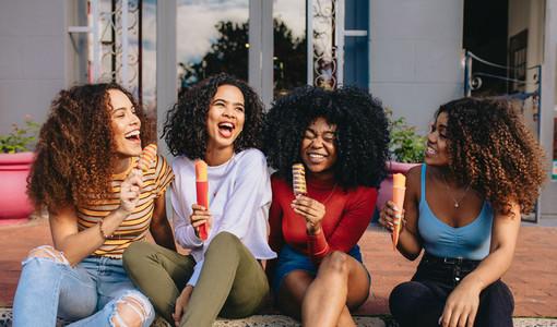 Girls enjoying ice lollies