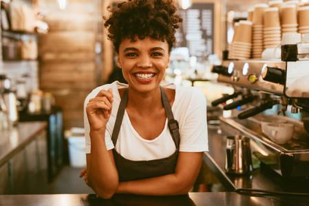 Female barista behind counter