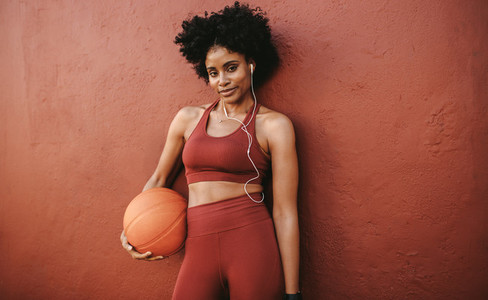Woman relaxing after basketball practice