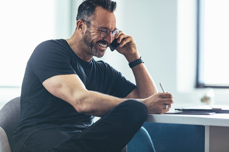 Mature businessman talking on cellphone