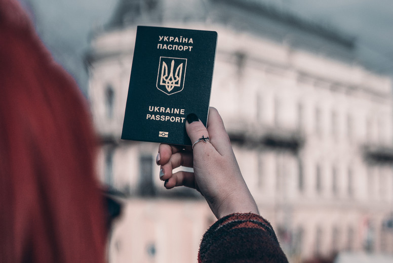 hands of the girl hold the passport in hand