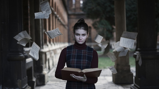 A girl with a book and a cold look