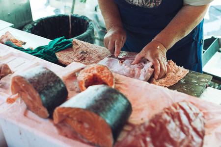 Portioning fish at fish market