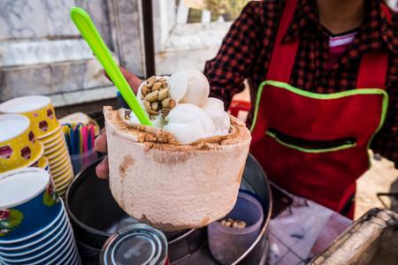Serving fresh coconut ice cream