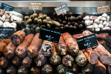 Showcase with dried salami