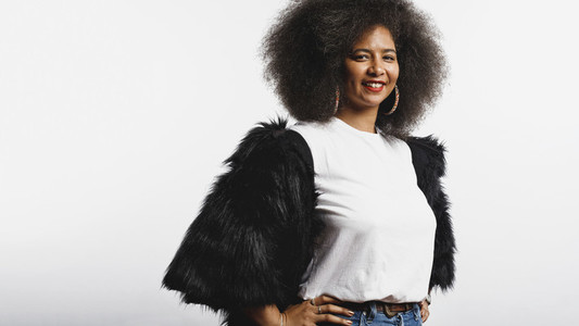 Smiling woman in afro hairstyle
