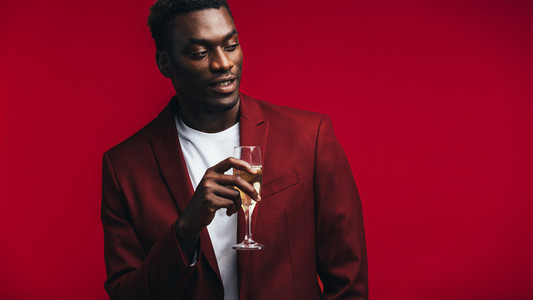 Stylish african man with champagne