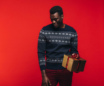 African guy with a gift