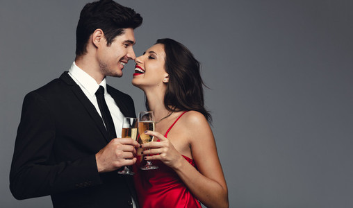 Happy young couple having champagne