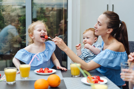 Happy family fresh fruit breakfast