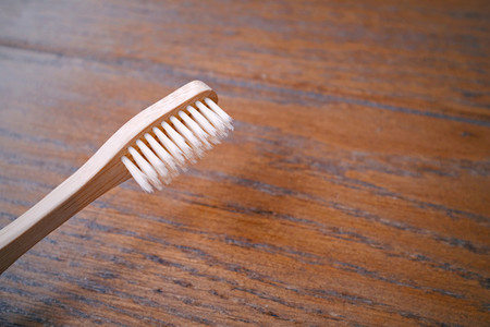 Close up of wooden bamboo toothbrush