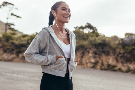 Fitness woman walking on country road
