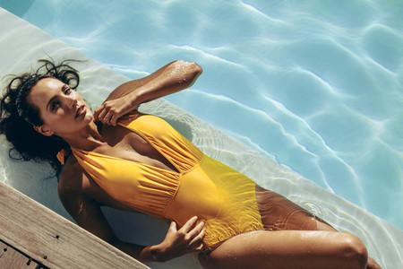 Bikini woman relaxing in the swimming pool