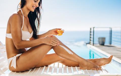 Woman sunbathing at the poolside