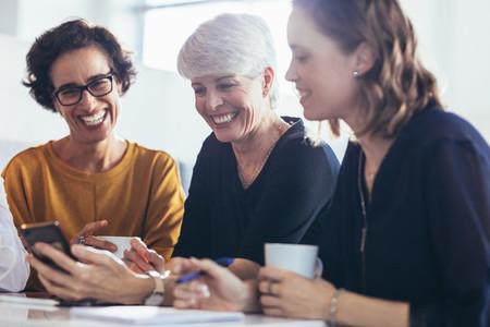Three businesswomen during break at office