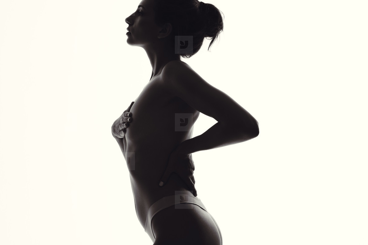 Silhouette of woman with slim body