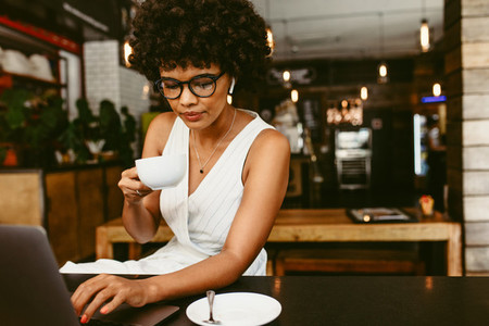 Woman sitting in cafe with a laptop