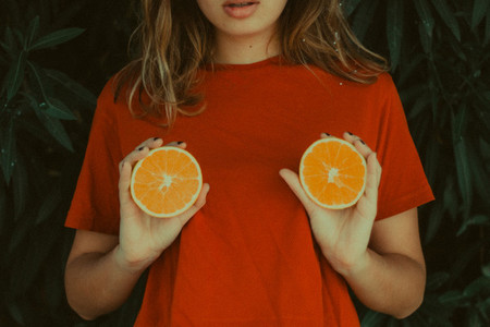 Girl and oranges