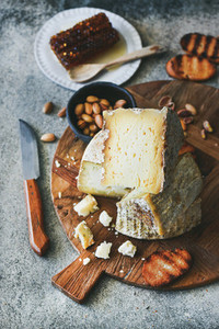 Cheese platter with cheese assortment  nuts  honey and bread