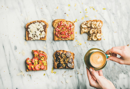 Healthy breakfast with wholegrain toasts  womans hands with espresso