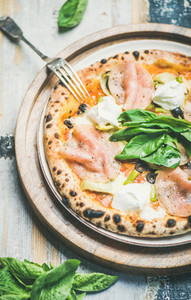 Freshly baked Italian pizza with ham  artichokes  cream cheese