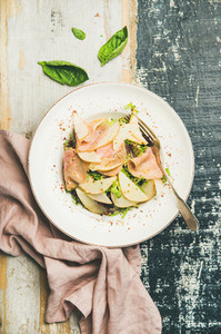 Summer salad with smoked turkey ham and pear  top view