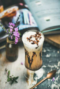 Iced mocha coffee with whipped cream in glass  wooden background