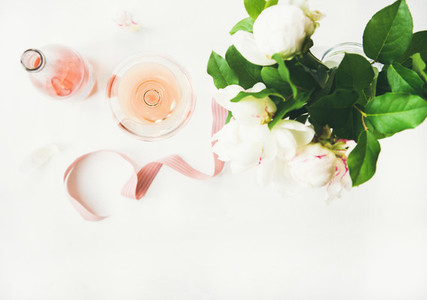 Rose wine and bouquet of peony flowers