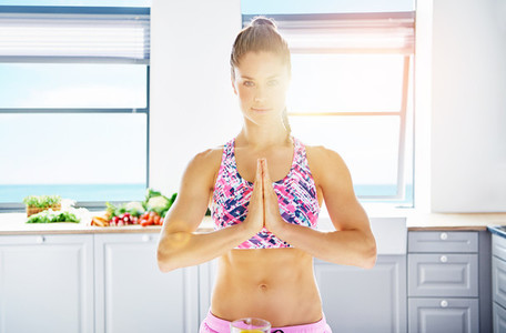 Content athletic woman posing while peaceful meditation