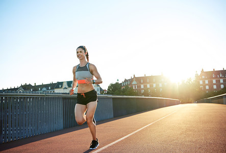 Athletic young woman enjoying a morning run