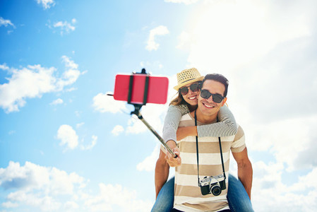 Happy young couple having fun taking a selfie