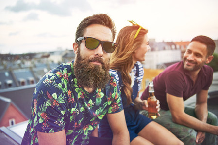 Handsome bearded man with friends on roof