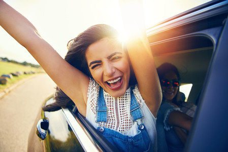 Exuberant young woman cheering with excitement