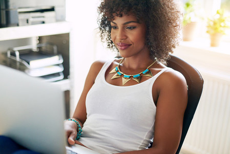 Black pretty girl using small business computer