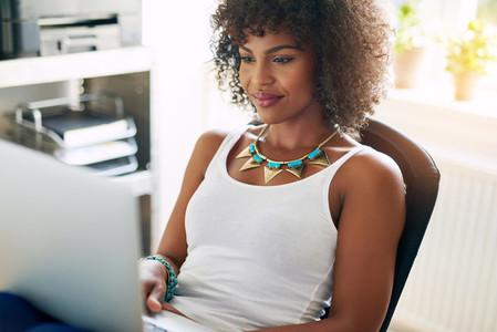 Black pretty girl using small business computer