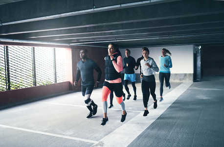 Young team of urban athletes training together