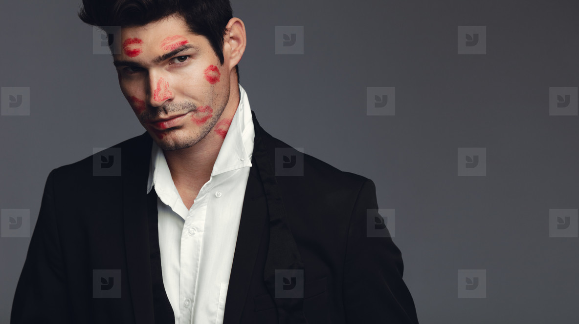 Stylish man covered with kisses