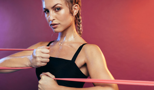Woman working out with resistance bands