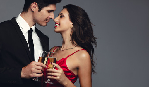 Beautiful couple celebrating with champagne