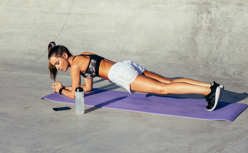 Fit female in a plank pose