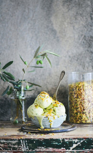 Bowl of pistachio ice cream on kitchen counter copy space