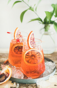 Aperol Spritz cocktail drink with orange and ice in glasses