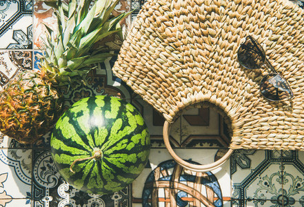 Summer lifestyle background with fruits and straw bag  close up