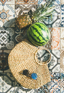 Summer lifestyle background with fruits and straw bag  vertical composition