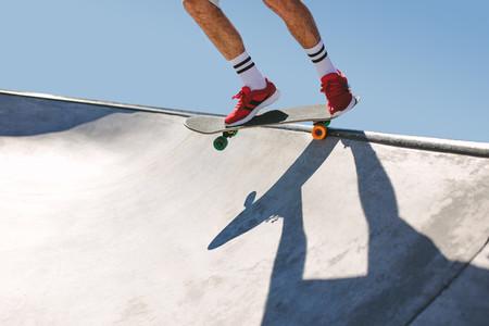 Skater in skate bowl
